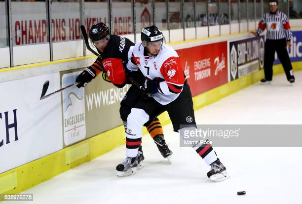 Alexander Karachun of Wolfsburg and Branislav Kubka of Bystrica battle for the puck during the Champions Hockey League match between Grizzlys...