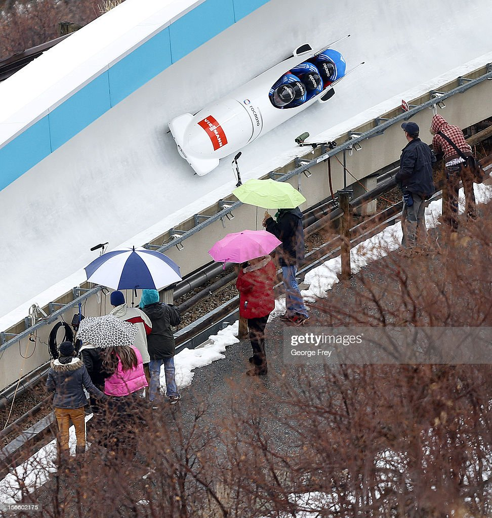 Alexander Kasjanov drives Russian 2 sled to a seventh place finish as spectators watch in the rain at the FIBT Men's Four Man Bobsled World Cup Heat 1 at Utah Olympic Park on November 17, 2012 in Park City, Utah.