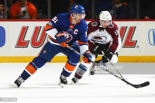 Alexander Kerfoot of the Colorado Avalanche chases down John Tavares of the New York Islanders as he carries the puck up ice at Barclays Center on...