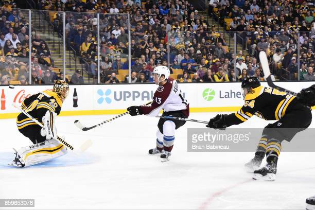 Alexander Kerfoot of the Colorado Avalanche shoots the puck against Tuukka Rask and Adam McQuaid of the Boston Bruins at the TD Garden on October 9...
