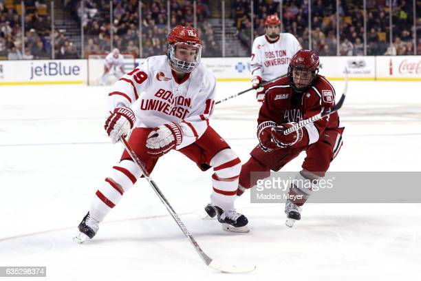 Alexander Kerfoot of the Harvard Crimson defends Clayton Keller of the Boston University Terriers during the 2017 Beanpot Tournament Championship at...