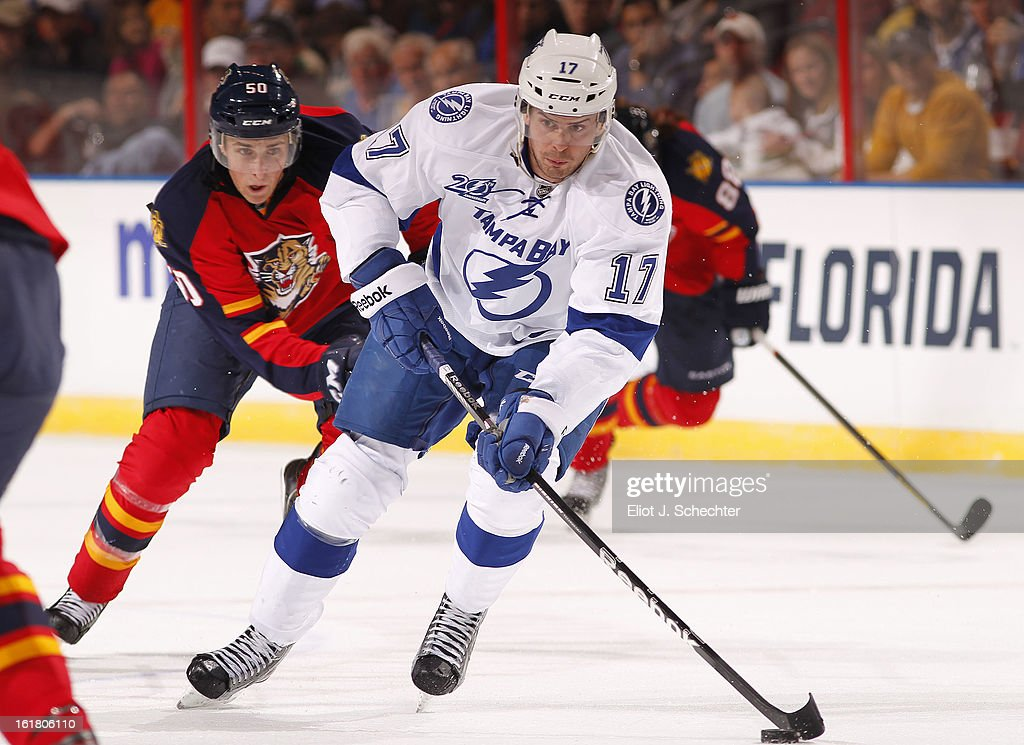Alexander Killorn #17 Tampa Bay Lightning skates with the puck against Drew Shore #50 of the Florida Panthers at the BB&T Center on February 16, 2013 in Sunrise, Florida.