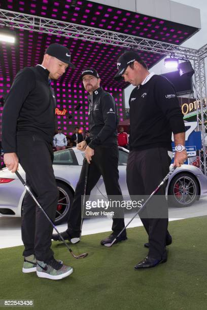 Alexander Knappe of Germany and Jimmy Walker and Patrick Reed of the United States attends the Porsche European Open Team Challenge at...