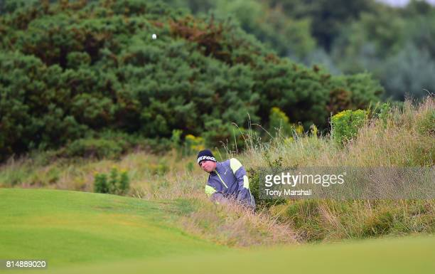 Alexander Knappe of Germany chips out of the rough on to the 3rd green during Day Three of the AAM Scottish Open at Dundonald Links Golf Course on...