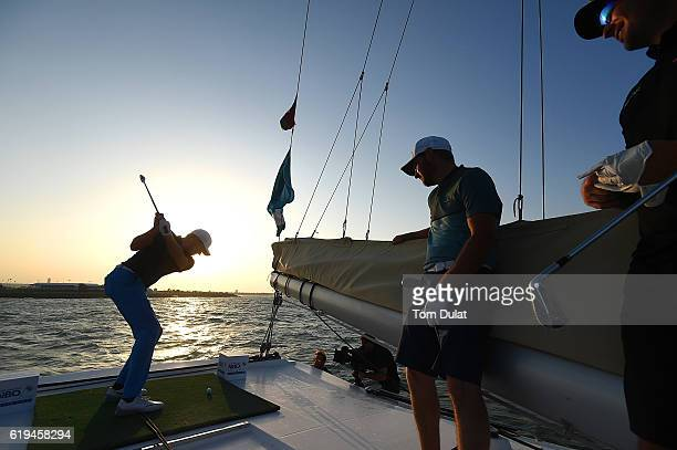 Alexander Knappe of Germany hits a ball from the boat at Al Mouj during previews of the NBO Golf Classic Grand Final at the Almouj Golf Club on...