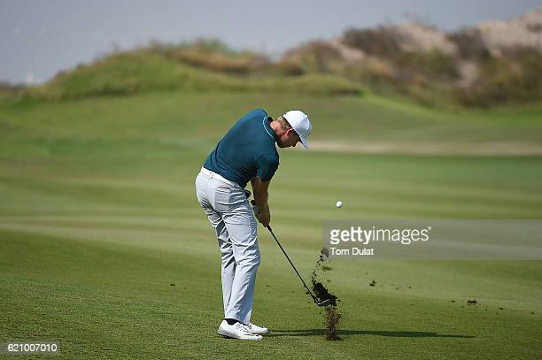 Alexander Knappe of Germany hits an approach shot on the 1st hole during day three of the NBO Golf Classic Grand Final at Al Mouj Golf on November 4...