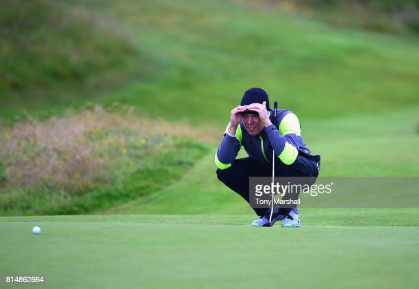 Alexander Knappe of Germany lines up his putt on the 2nd green during Day Three of the AAM Scottish Open at Dundonald Links Golf Course on July 15...