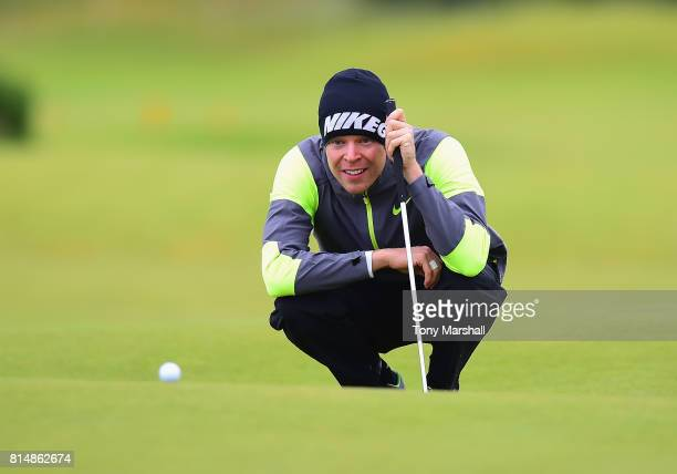 Alexander Knappe of Germany lines up his putt on the 3rd green during Day Three of the AAM Scottish Open at Dundonald Links Golf Course on July 15...