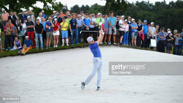 Alexander Knappe of Germany plays out of a bunker on the 6th fairway during the Porsche European Open Day Four at Green Eagle Golf Course on July 30...