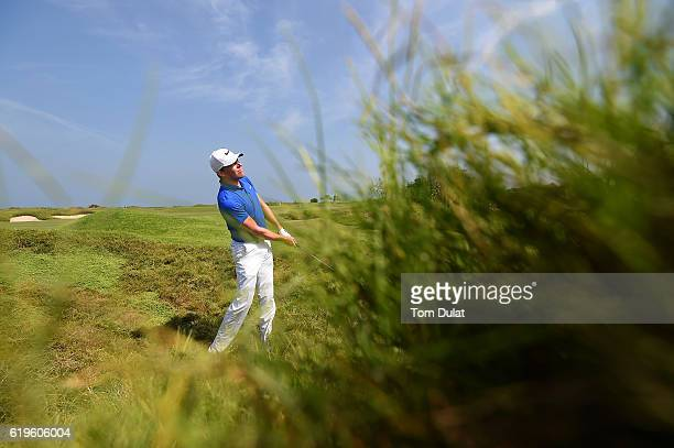 Alexander Knappe of Germany takes a shot out of the rough on the 10th hole during previews of the NBO Golf Classic Grand Final at the Almouj Golf...