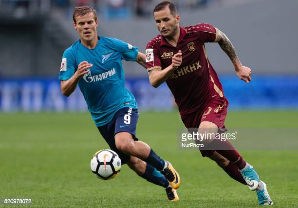 Alexander Kokorin of FC Zenit Saint Petersburg and Fedor Kudryashov of FC Rubin Kazan vie for the ball during the Russian Football League match...