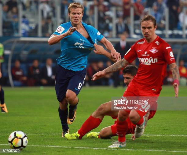 Alexander Kokorin of FC Zenit SaintPetersburg in action against Salvatore Bocetti of FC Spartak Moscow during the Russian Premiere League match...
