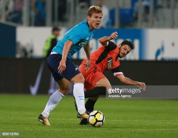 Alexander Kokorin of FC Zenit St Petersburg in action against Yuval Ashkenazi of Bnei Yehuda Tel Aviv FC during the UEFA Europa League third...