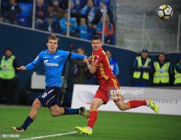 Alexander Kokorin of FC Zenit St Petersburg vies for the ball with Ilya Maximov of FC Arsenal Tula during the during the Russian Premier League match...
