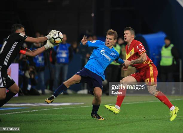 Alexander Kokorin of FC Zenit St Petersburg vies for the ball with Ilya Maximov and Vladimir Gabulov of FC Arsenal Tula during the during the Russian...