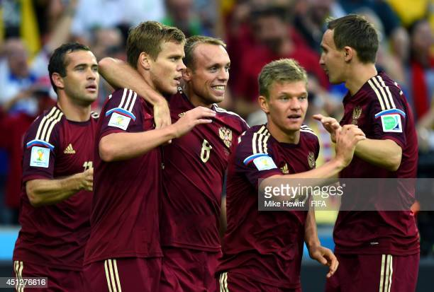 Alexander Kokorin of Russia celebates scoring his team's first goal with his teammates during the 2014 FIFA World Cup Brazil Group H match between...