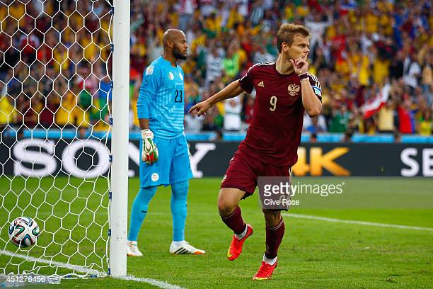 Alexander Kokorin of Russia celebrates scoring his team's first goal past Rais M'Bolhi of Algeria during the 2014 FIFA World Cup Brazil Group H match...