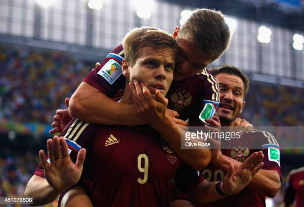Alexander Kokorin of Russia celebrates scoring his team's first goal with teammate Oleg Shatov on his back during the 2014 FIFA World Cup Brazil...