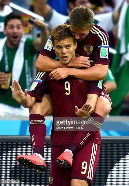 Alexander Kokorin of Russia celebrates scoring his team's first goal with his teammate Oleg Shatov during the 2014 FIFA World Cup Brazil Group H...