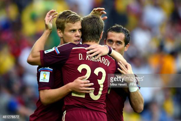 Alexander Kokorin of Russia celebrates scoring his team's first goal with his teammate Dmitry Kombarov and Aleksandr Kerzhakov during the 2014 FIFA...