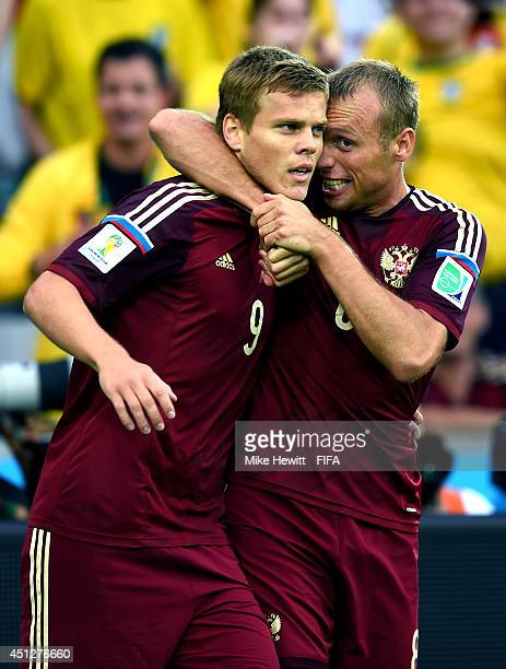 Alexander Kokorin of Russia celebrates scoring his team's first goal with his teammate Denis Glushakov of Russia during the 2014 FIFA World Cup...