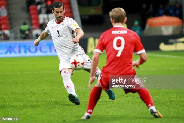 Alexander Kokorin of Russia in action against Ehsan Hajsafi of Iran during the International friendly soccer match between Russia and Iran at Kazan...