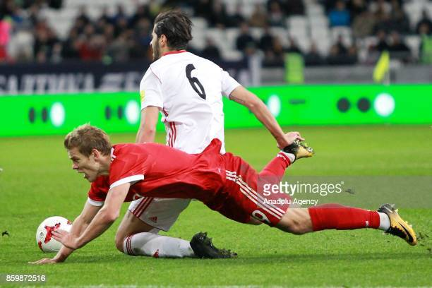 Alexander Kokorin of Russia in action against Saeid Ezatolahi of Iran during the International friendly soccer match between Russia and Iran at Kazan...