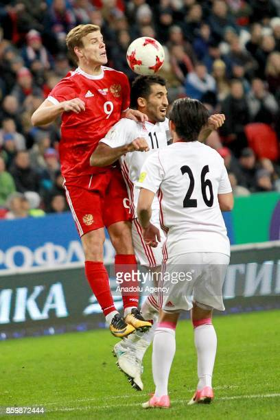 Alexander Kokorin of Russia in action against Vahid Amiri and Akbar Imani of Iran during the International friendly soccer match between Russia and...