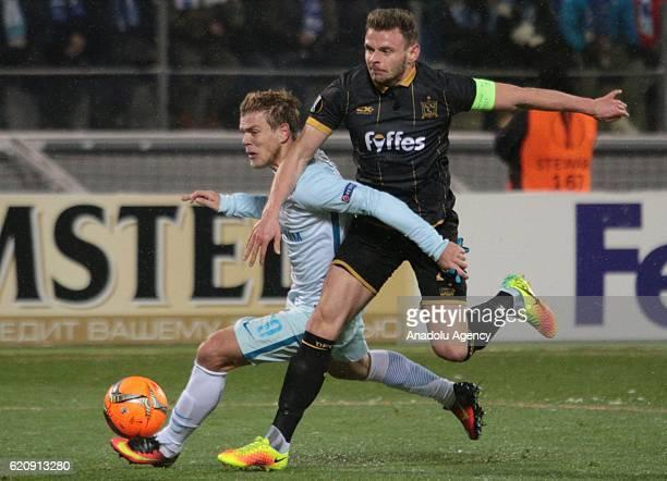Alexander Kokorin of Zenit SaintPetersburg in action against Sean Gannon of Dundalk FC during UEFA Europa League match between Zenit StPetersburg and...