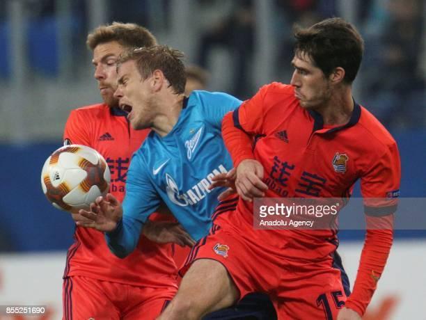 Alexander Kokorin of Zenit St Petersburg is in action against Aritz Elustondo and Asier Illaramendi of Real Sociedad during the UEFA Europa League...