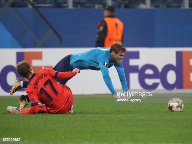 Alexander Kokorin of Zenit St Petersburg is in action against David Zurutuza of Real Sociedad during the UEFA Europa League Group L football match...