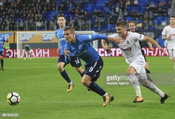 Alexander Kokorin of Zenit St Petersburg is in action against Igor Denisov of Lokomotiv Moscow during the Russian Football PremiereLeague match...