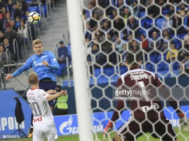 Alexander Kokorin of Zenit St Petersburg is in action against Vladislav Ignatyev of Lokomotiv Moscow during the Russian Football PremiereLeague match...