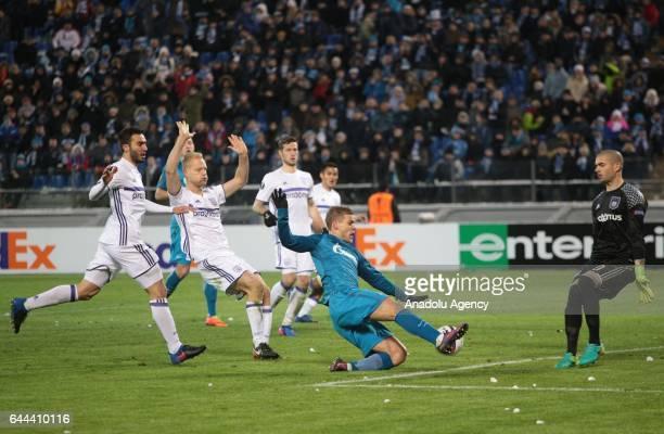 Alexander Kokorin of Zenit StPetersburg in action against players of RSC Anderlecht during Europa League Round of 32 football match between Zenit...