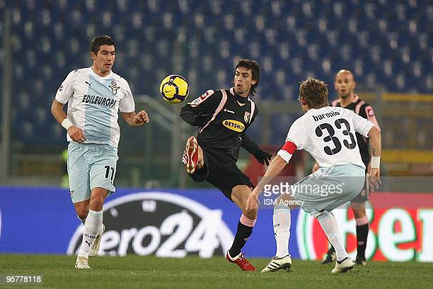 Alexander Kolarov and Roberto Baronio of SS Lazio and Javier Pastore of US citta' di Palermo in action during the Tim Cup between Lazio and Palermo...