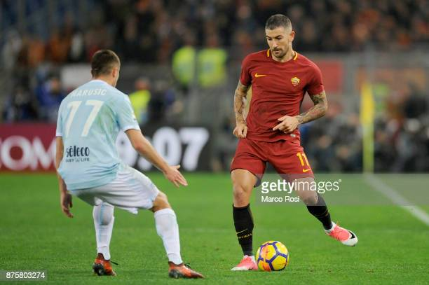 Alexander Kolarov of AS Roma compete for the ball with Adam Marusic of SS Lazio during the Serie A match between AS Roma and SS Lazio at Stadio...