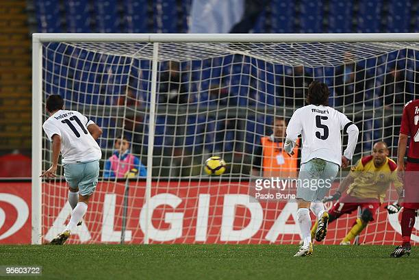 Alexander Kolarov of SS Lazio scores the fourth goal from the penalty spot during the Serie A match between Lazio and Livorno at Stadio Olimpico on...