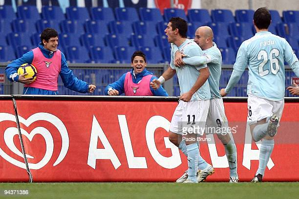 Alexander Kolarov Tommaso Rocchi and Stefan Radu of SS Lazio celebrate the opening goal during the Serie A match between Lazio and Genoa at Stadio...