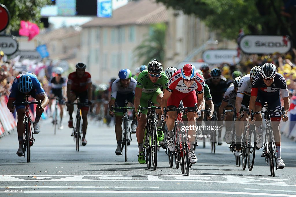 <a gi-track='captionPersonalityLinkClicked' href=/galleries/search?phrase=Alexander+Kristoff&family=editorial&specificpeople=6165249 ng-click='$event.stopPropagation()'>Alexander Kristoff</a> (C) of Noraway and Team Katusha sprints to victory as Jack Bauer (L) of New Zealand and Garmin-Sharp has his breakaway ended by the field sprint during the fifteenth stage of the 2014 Tour de France, a 222km stage between Tallard and Nimes, on July 20, 2014 in Nimes, France.