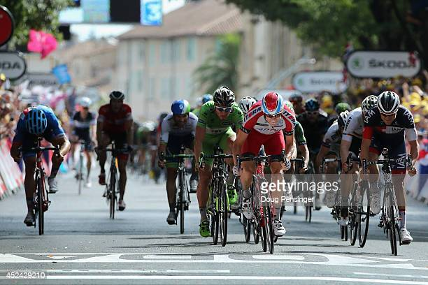 Alexander Kristoff of Noraway and Team Katusha sprints to victory as Jack Bauer of New Zealand and GarminSharp has his breakaway ended by the field...