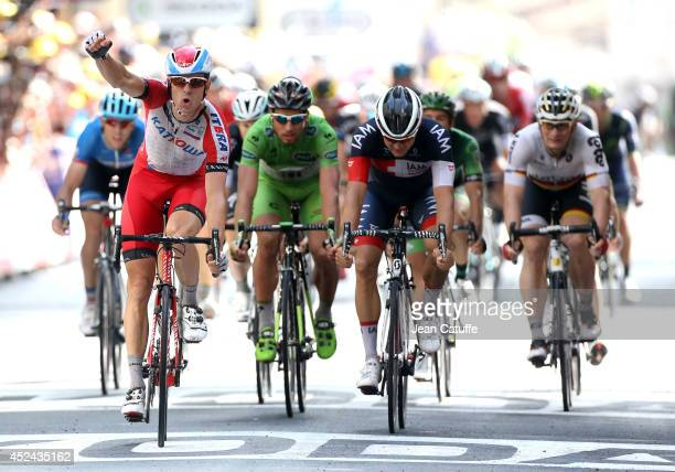 Alexander Kristoff of Norway and Team Katusha celebrates winning in front of Heinrich Haussler of Australia and Iam Cycling Peter Sagan of Slovakia...