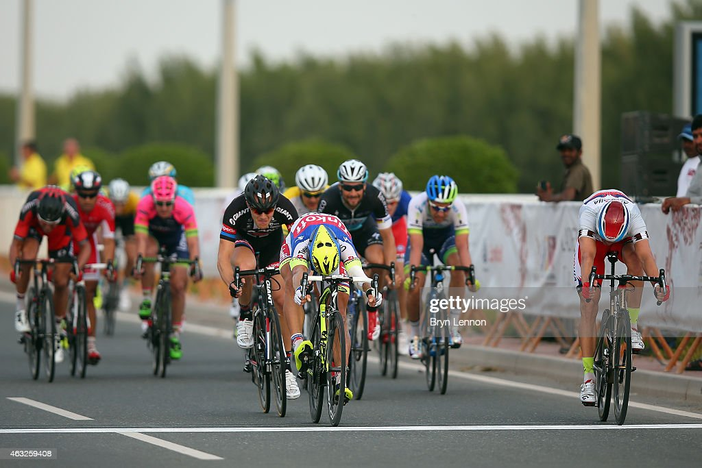 <a gi-track='captionPersonalityLinkClicked' href=/galleries/search?phrase=Alexander+Kristoff&family=editorial&specificpeople=6165249 ng-click='$event.stopPropagation()'>Alexander Kristoff</a> (r) of Norway and Team Katusha wins the final sprint from <a gi-track='captionPersonalityLinkClicked' href=/galleries/search?phrase=Peter+Sagan&family=editorial&specificpeople=4846179 ng-click='$event.stopPropagation()'>Peter Sagan</a> of Slovakia and Tinoff-Saxo during stage five of the 2015 Tour of Qatar, a 153km road stage from Al Zubarah Fort to Al Madinat Al Shamal on February 12, 2015 in Al Madinat Al Shamal, Qatar.