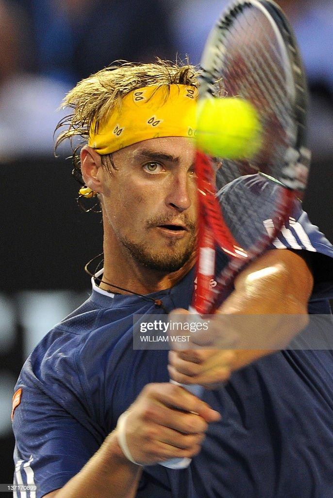 <b>Alexander Kudryavtsev</b> of Russia hits a return against Roger Federer of ... - alexander-kudryavtsev-of-russia-hits-a-return-against-roger-federer-picture-id137170899