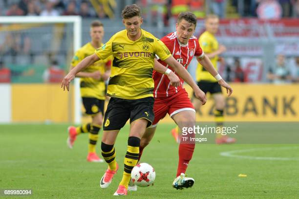 Alexander Laukart of Dortmund and Adrian Fein of Munich battle for the ball during the U19 German Championship Final match between U19 Borussia...