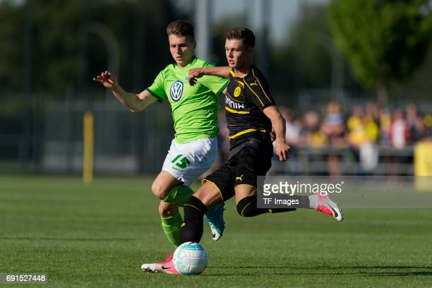 Alexander Laukart of Dortmund and Yannik Moeker of Wolfsburg battle for the ball during the U19 German Championship Semi Final second leg match...