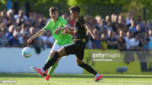Alexander Laukart of Dortmund challenges David Nieland of Wolfsburg during the U19 German Championship Semi Final second leg match between Borussia...
