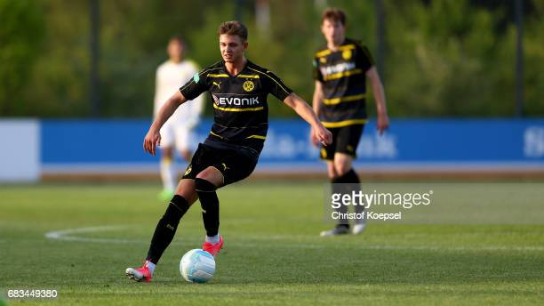 Alexander Laukart of Dortmund runs with the ball during the U19 German Championship Semi Final second leg match between Borussia Dortmund and VfL...