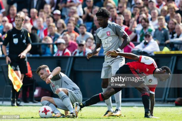 Alexander Laukart of FC Twente Isaac BuckleyRicketts of FC Twente Ridgeciano Haps of Feyenoord during the Dutch Eredivisie match between Feyenoord...