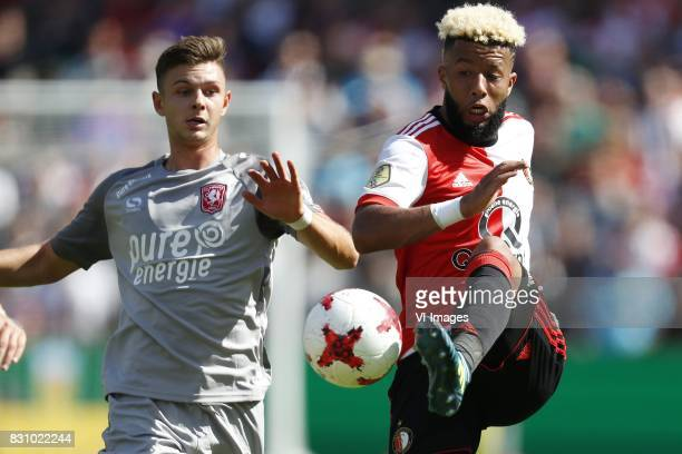 Alexander Laukart of FC Twente Tonny Vilhena of Feyenoord during the Dutch Eredivisie match between Feyenoord Rotterdam and FC Twente at the Kuip on...