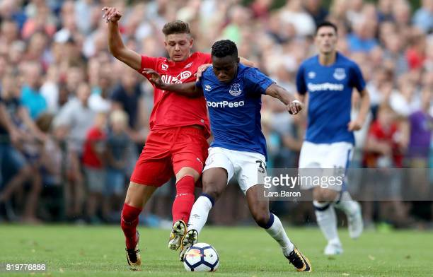 Alexander Laukart of Twente challenges Ademola Lookman of Everton during a preseason friendly match between FC Twente and Everton FC at Sportpark de...